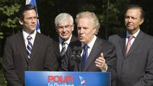 Quebec Liberal Leader Jean Charest flanked by local Quebec City candidates, responds to questions at a news conference Aug. 27, 2012. (Jacques Boissinot/THE CANADIAN PRESS)