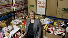 Food Bank executive director Marjorie Bencz, pictured in Edmonton on Christmas Eve, says Alberta has more working poor than than any other people. (Jason Franson For The Globe and Mail)