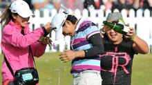 Women's British Open champion Yani Tseng celebrates with Christina Kim (Martin Rickett)