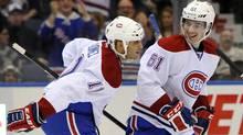 Montreal Canadiens' Scott Gomez celebrates his goal with Raphael Diaz against New York Islanders goalie Evgeni Nabokov in the third period of an NHL hockey game, Thursday. (Kathy Kmonicek/Associated Press)