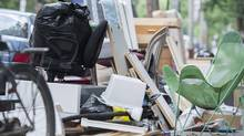 Discarded furniture is shown on a street in Montreal, Tuesday, July 1, 2014, on what's now known as moving day in Quebec. (Graham Hughes/THE CANADIAN PRESS)