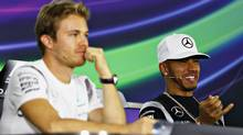 Nico Rosberg of Germany and Lewis Hamilton of Great Britain conduct a press conference during previews for the Abu Dhabi Formula One Grand Prix at Yas Marina Circuit on November 24, 2016 in Abu Dhabi, United Arab Emirates. (Clive Mason/Getty Images)