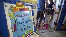 A signboard outside a kindergarten classroom has names attached to it at Wilkinson Public School on Sept 2 2014. Today marked the return to the classroom for students across Toronto. (Fred Lum/The Globe and Mail)