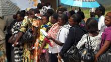 Women line up at a heath centre to receive HIV and cervical cancer counselling and testing in Uganda on June 19, 2012. (UNFPA/Omar Gharzeddine)