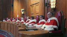 Canada's Supreme Court Justices take part in a welcoming ceremony at the Supreme Court of Canada in Ottawa October 6, 2015. From L-R: Suzanne Cote, Richard Wagner, Michael Moldaver, Rosalie Abella, Chief Justice Beverley McLachlin, Thomas Cromwell, Andromache Karakatsanis, Clement Gascon and Russell Brown. (CHRIS WATTIE/REUTERS)