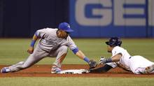 Tampa Bay Rays' Desmond Jennings beats the tag at second by Toronto Blue Jays Maicer Izturis Thursday. (Kim Klement/USA Today Sports)