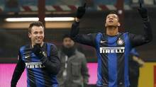 Inter Milan's Guarin (R) celebrates with his teammate Antonio Cassano after scoring against Napoli during their Serie A soccer match at San Siro stadium in Milan, December 9, 2012. (Reuters)