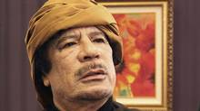 Colonel Moammar Gaddafi poses after an interview with TRT Turkish television in Tripoli on March 8, 2011. (STR/Huseyin Dogan/Reuters)
