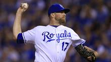 In this Sept. 17, 2016, file photo, Kansas City Royals relief pitcher Wade Davis throws during a baseball game against the Chicago White Sox, at Kauffman Stadium in Kansas City, Mo. In a trade between the last two champions, the Cubs acquired the all-star reliever from the Kansas City Royals on Wednesday for outfielder Jorge Soler. (Orlin Wagner/AP)
