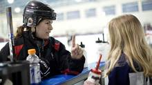 Canadian hockey gold medalist Katie Weatherston in Rockland, Ontario March 16, 2011. Katie tracks the eye movement of a girl who hit her head while on the ice and complained of headaches and dizziness. (Blair Gable/© 2011, Blair Gable Photography)