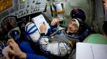 Bob Thirsk training in a Soyuz Capsule simulator prior to his mission.