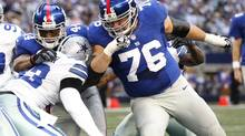 FILE - In this Oct. 28, 2012 file photo, New York Giants' Ahmad Bradshaw (44) and Chris Snee (76) block Dallas Cowboys' Anthony Spencer (93) during the first half of an NFL football game in Arlington, Tex. (Tony Gutierrez/AP)