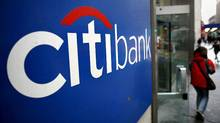 A customer exits a Citibank branch at 40th St. and Broadway in New York Tuesday, Nov. 25, 2008. (Craig Ruttle/AP)