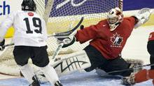 Canadian national junior team goaltender Matt Hackett stops Plymouth Whalers teammate Tyler Seguin during an intra-squad game Sunday, December 13, 2009 as the team opens its selection camp for the World Junior Championships in Regina. THE CANADIAN PRESS/Ryan Remiorz (Ryan Remiorz)