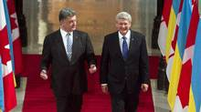 Ukrainian president Petro Poroshenko granted the Order of Liberty to Stephen Harper to mark the 25th anniversary of Ukraine's independence this week. (FRED CHARTRAND/THE CANADIAN PRESS)