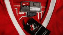 Images of fake Team Canada replica hockey jerseys for a story about fake hockey jerseys and how they can impact the earnings for NHL teams and the league. The Olympic patch on the sleeve of the fake should have five multi-coloured rings, whereas the ones on the genuine should be a single colour. The Hockey Canada patch on the other sleeve should be roughly half as big on the real one as it is on the fake. The fake jersey has a fighting strap on the inside. Real Team Canada replica jerseys don't have tie-downs. There are also significant differences in the texture of the materials . There are also differences with the printed logo on the Canada crest on the front of the jersey. The print on the fake does not line up properly with the outline of the maple leaf. Also, on the real replica, the name is printed on the name patch and then sewn onto the jersey. On the fake the sewing is done through the letters and the inner material, and so is visible inside. Images were done in the studio of The Globe and Mail in Toronto, Ontario on Oct. 3, 2011.(Photo by Peter Power/The Globe and Mail) (Peter Power/The Globe and Mail)
