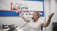 Lifeline Syria's Chair Ratna Omidvar, centre right, works with volunteers at the organization's offices in Toronto on Friday, September 4, 2015. (Chris Young/THE CANADIAN PRESS)