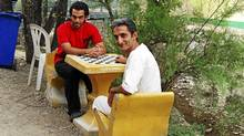 At one of Rebirth's detox and rehab centres for drug addicts, Behza Zarbakhsh, 25, an accountant, and Babak Enayati, 42, a goldsmith, are mid-way through a three-month stint at a valley site on the Verdij River, west of Tehran where they live in dormitories built by addicts. (Paul Koring/The Globe and Mail/Paul Koring/The Globe and Mail)