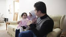 Raid Abazeed his wife Manar Alsaid Ahmed and their 14-month-old daughter Salma at their home in Burnaby, British Columbia, Tuesday, December 20, 2016. They arrived from Jordan in January of 2016 after fleeing the conflict in Syria. (Rafal Gerszak/Rafal Gerszak)