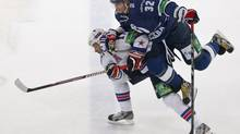 Dynamo Moscow's Alexander Ovechkin (R) challenges SKA St. Petersburg's Ilya Kovalchuk during their Kontinental Hockey League (KHL) game in Moscow September 23, 2012. (MAXIM SHEMETOV/REUTERS)