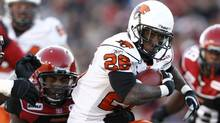 BC Lions' Stefan Logan (26) runs against the Calgary Stampeders during the first half of their CFL Western Final football game in Calgary, Alberta, November 15, 2008. (Reuters)