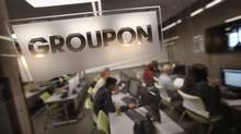 The Groupon logo is engraved in a glass office partition in the company's international headquarters on June 10, 2011 in Chicago, Illinois. (Scott Olson/2011 Getty Images)