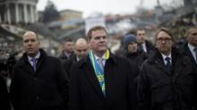 Canada's Minister of Foreign Affairs John Baird, center, walks in Kiev's Independence Square, the epicenter of the country's current unrest, Ukraine, Friday, Feb. 28. (Emilio Morenatti/AP)