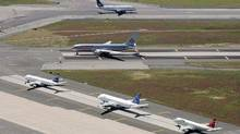 File photo of planes lined up on the runway at John F. Kennedy International in New York. (Mark Lennihan/AP Photo)