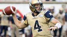 Winnipeg Blue Bombers quarterback Buck Pierce fires a pass as they face the Montreal Alouettes during first quarter CFL football action Thursday, July 4, 2013 in Montreal. (Paul Chiasson/THE CANADIAN PRESS)