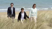 Prime Minister Justin Trudeau, left, Sophie Gregoire-Trudeau and their son Xavier visit Juno Beach in Courseulles-sur-Mer, France, on April 10, 2017. (Adrian Wyld/THE CANADIAN PRESS)