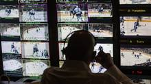 Senior producer Sherali Najak looks over content in the broadcast truck for Hockey Night in Canada in December, 2014. (Mark Blinch/The Globe and Mail)
