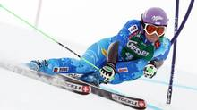 Slovenia's Tina Maze clears a gate during the first run of an alpine ski, women's World Cup giant slalom, in Soelden, Austria, Saturday, Oct. 27, 2012. (Alessandro Trovati/AP)