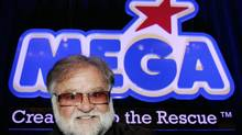 Mega Bloks chairman Victor J. Bertrand with his company's newly unveiled logo, at his company's annual meeting in Montreal on June 15, 2006. (Ian Barrett/The Canadian Press)