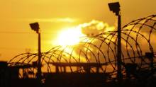 The sun rises over the U.S. detention center at U.S. Naval Base Guantanamo Bay October 18, 2012 in this photo reviewed by the U.S. Department of Defense. (Michelle Shephard/Pool photo via REUTERS)