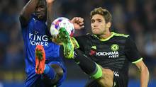 Chelsea defender Marcos Alonso, right, vies with Leicester City striker Jeff Schlupp during their EFL Cup third-round match on Sept. 20, 2016. (Anthony Devlin/AFP/Getty Images)