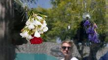 Flowers are placed at the scene of a shooting by Elliot Rodger in California. Rodger's parents tried to alert authorities about their son. (LUCY NICHOLSON/REUTERS)