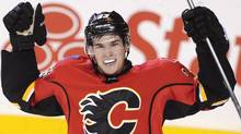 Calgary Flames' Sean Monahan celebrates scoring the winning goal against the New Jersey Devils during third period NHL action in Calgary, Alta., Friday, October 11, 2013. (The Canadian Press)