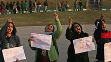 University students shout slogans as they protest in support of safety for women in New Delhi on Friday, Jan. 4. (Manish Swarup/Associated Press)