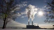 Smoke pours from the stacks at the Portlands Energy Centre in Toronto, January 15, 2009. (Frank Gunn/THE CANADIAN PRESS)