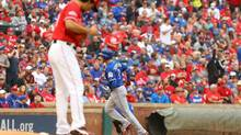 Jays' Troy Tulowitzki rounds the bases after hitting a home run off Yu Darvish of the Texas Rangers in the second inning of game two of the American League Divison Series. (Scott Halleran/Getty Images)