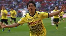 Borussia Dortmund's Shinji Kagawa celebrates a goal against Cologne during the German first division Bundesliga soccer match in Cologne on Sunday. (INA FASSBENDER)