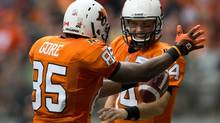 B.C. Lions' Shawn Gore, left, celebrates his touchdown reception with quarterback Travis Lulay during the first half of a CFL football game against the Montreal Alouettes in Vancouver, B.C., on Sunday September 15, 2013. (DARRYL DYCK/THE CANADIAN PRESS)