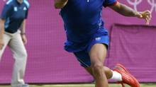 Jo-Wilfried Tsonga remained on course to defend his Metz Open title with a three-set semi-final victory over Nikolay Davydenko on Saturday. (Phil Noble/REUTERS)