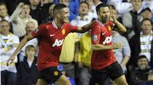 Manchester United's Ryan Giggs (R) celebrates scoring with Federico Macheda during their English League Cup soccer match against Leeds United in Leeds, northern England September 20, 2011. (NIGEL RODDIS/REUTERS)