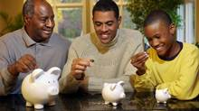 Family saving money (© Thinkstock LLC)