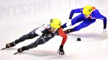 Canada's Charles Hamelin, left, speeds on track during the Men's 1500 meters quarterfinal at the Short Track World Cup, in Turin, Italy, Saturday. Nov. 9, 2013. (Massimo Pinca/AP)