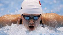 China's Ye Shiwen swims to a first place finish during heat 5 of the women's 200m individual medley event at the London 2012 Olympic Games at the Aquatics Centre July 30, 2012. (DAVID GRAY/REUTERS)