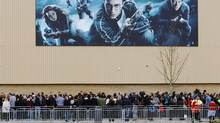Fans wait to see actors from the Harry Potter films at the opening of the Warner Brothers Studio Tour- The Making of Harry Potter near Watford north London March 31, 2012. (LUKE MACGREGOR/Reuters)