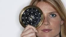 Portrait of businesswoman with compass (Comstock/Getty Images/Comstock Images)