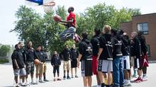 Andrew Wiggins goes up for a dunk while filming a commercial as children look on in Concord, Ont., <240>on Monday.<240> (Nathan Denette/THE CANADIAN PRESS)